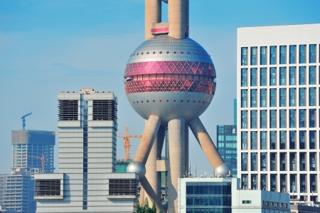 excluding: SHANGHAI, CHINA - MAY 27: Oriental Pearl Tower over river on May 27, 2012 in Shanghai, China. The tower was the tallest structure in China excluding Taiwan from 1994¨C2007 and the landmark of Shanghai.