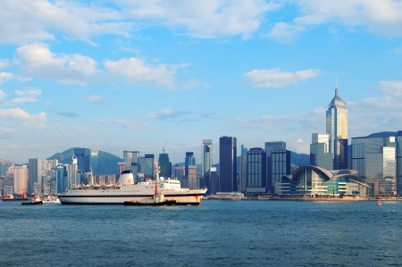 Hong Kong skyline with boats in Victoria Harbor.  photo