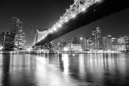 Queensboro Bridge over New York City East River black and white at night with river reflections and midtown Manhattan skyline illuminated.  Stock Photo - 15375561