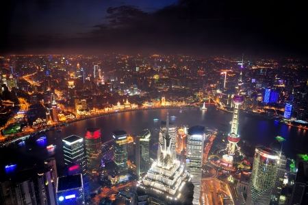 pudong: Shanghai city aerial view at night with lights and urban architecture