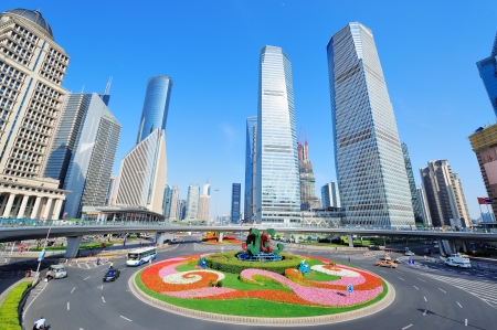 shanghai china: Shanghai street view with skyscrapers, roundabout and blue sky.