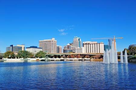 florida landscape: Orlando Lake Lucerne panorama in the morning with office buildings, bridge and fountain Stock Photo