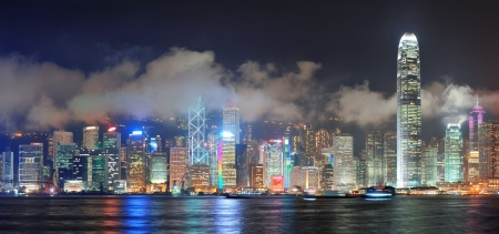hong kong night: Hong Kong skyline at night with clouds over Victoria Harbour  Stock Photo