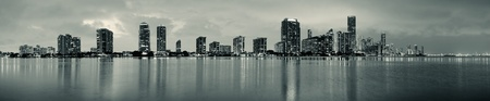 Miami city skyline panorama at dusk with urban skyscrapers over sea with reflection Stock Photo - 15382223