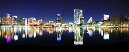 orlando: Orlando downtown skyline panorama over Lake Eola at night with urban skyscrapers and clear sky  Stock Photo