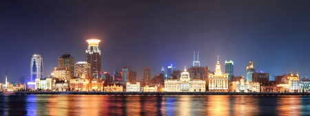 huangpu: Shanghai historic architecture panorama at night lit by lights over Huangpu River