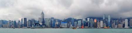 hong kong people: Urban architecture in Hong Kong Victoria Harbor with city skyline and cloud in the day