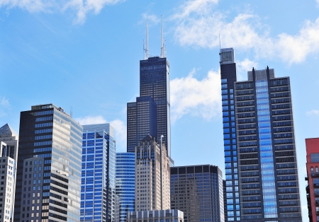 Chicago city downtown urban skyline with skyscrapers and cloudy blue sky.