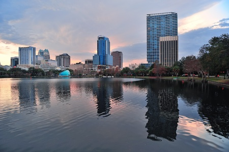 Orlando Lake Eola sunset with urban architecture skyline and colorful cloud photo