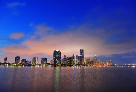 Miami city skyline panorama at dusk with urban skyscrapers over sea with reflection Stock Photo - 15653989