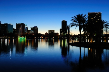 Orlando downtown skyline panorama silhouette over Lake Eola at dusk with urban skyscrapers. photo