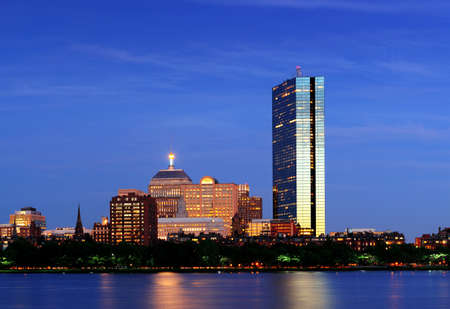 hancock building: Boston Charles River at dusk with urban city skyline and light reflection Stock Photo