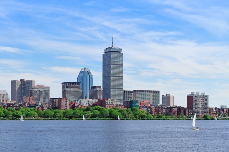 prudential: Boston city skyline with Prudential Tower and urban skyscrapers over Charles River with boat