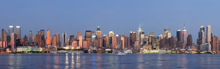 weehawken: Hudson River waterfront view of New York City Manhattan after sunset with cityscape panorama and light reflection in tranquil blue tone  Editorial