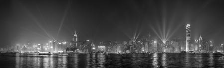 Hong Kong skyline at night with lights and skyscrapers black and white photo
