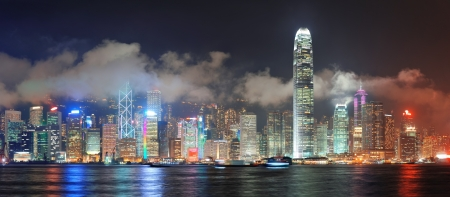 Hong Kong skyline at night with clouds over Victoria Harbour. photo