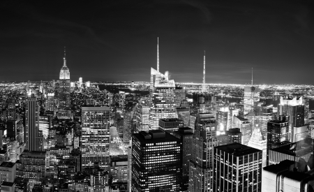 new york: New York City Manhattan skyline at night panorama black and white with urban skyscrapers