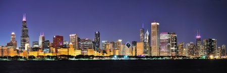 Chicago city downtown urban skyline panorama at dusk with skyscrapers over Lake Michigan with clear blue sky  Stock Photo - 15656219