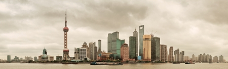 Shanghai skyline over river in overcast day