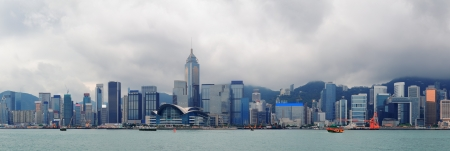 hong kong harbour: Urban architecture in Hong Kong Victoria Harbor with city skyline and cloud in the day
