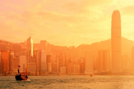 Hong Kong skyline with boats in Victoria Harbor in red tone.  Stok Fotoğraf