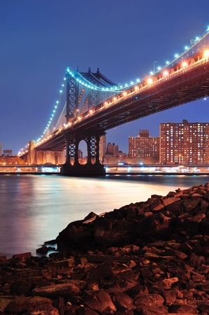 New York City Manhattan Bridge closeup with downtown skyline over East River. photo