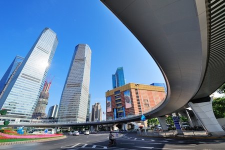 traffic building: Shanghai street view with skyscrapers and blue sky. Stock Photo