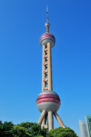 excluding: SHANGHAI, CHINA - MAY 28: Oriental Pearl Tower closeup on May 28, 2012 in Shanghai, China. The tower was the tallest structure in China excluding Taiwan from 1994�C2007 and the landmark of Shanghai.