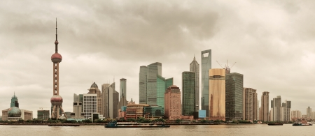 pudong district: Shanghai skyline over river in overcast day