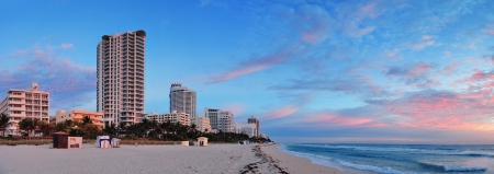Miami South Beach sunrise panorama with hotels and colorful cloud and blue sky