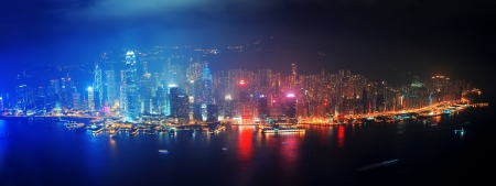 kong: Victoria Harbor aerial view with Hong Kong skyline and urban skyscrapers at night