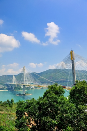 Ting Kau Bridge in Hong Kong over sea in the day with blue sky photo