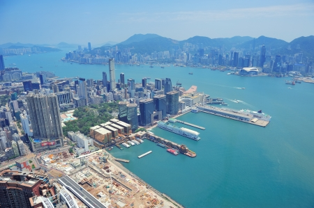 Hong Kong aerial view panorama with urban skyscrapers boat and sea.  photo
