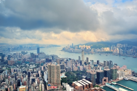 hong kong people: Victoria Harbor aerial view and skyline in Hong Kong with urban skyscrapers.