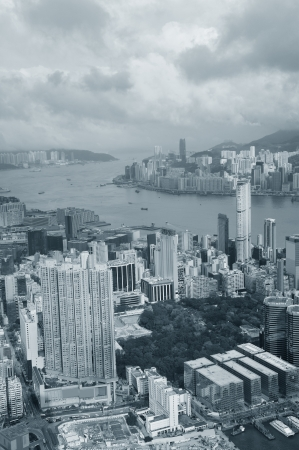 Victoria Harbor aerial view and skyline in Hong Kong with urban skyscrapers in black and white. photo