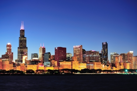 chicago skyline: Chicago city downtown urban skyline at dusk with skyscrapers over Lake Michigan with clear blue sky.