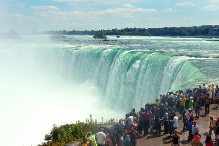 horseshoe falls: NIAGARA FALLS, NY - SEPT 1: Visitors watch Horseshoe Falls on September 1, 2012 in Niagara Falls, New York. Niagara Falls is the waterfalls with the highest flow rate in the world.