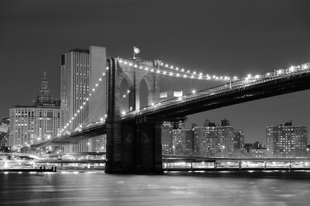 new york: New York City Brooklyn Bridge black and white with downtown skyline over East River. Stock Photo