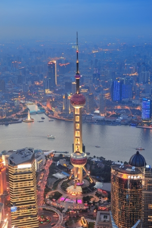 pudong: Shanghai aerial view at sunset with urban skyscrapers over river