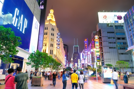 longest: SHANGHAI, CHINA - MAY 28: Nanjing Road street night view on May 28, 2012 in Shanghai, China. Nanjing Road is 6km long as the worlds longest shopping district with 1M visitors daily.