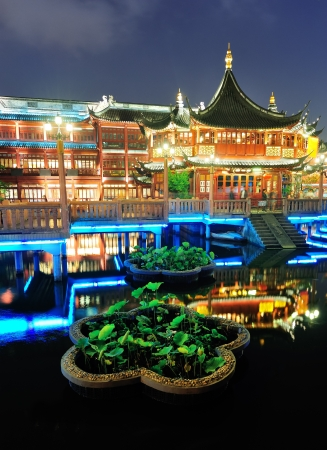 Historical pagoda stile building in Shanghai at night  photo