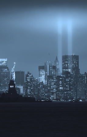 New York City Manhattan downtown skyline black and white at night with statue of liberty and light beams in memory of September 11 viewed from New Jersey waterfront  Stock Photo - 16152139