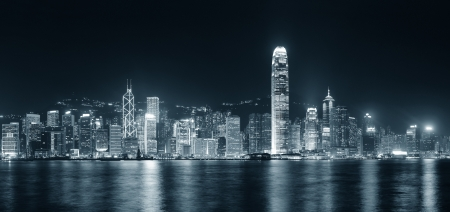 hong kong night: Hong Kong city skyline at night over Victoria Harbor with clear sky and urban skyscrapers