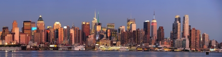 weehawken: New York City Manhattan sunset panorama with historical skyscrapers over Hudson River with beautiful red color sunshine reflection viewed from New Jersey Weehawken waterfront