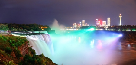 Niagara Falls lit at night panorama by colorful lights photo