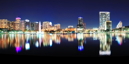 Orlando downtown skyline panorama over Lake Eola at night with urban skyscrapers and clear sky Stock Photo - 16156566