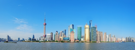 shanghai pudong skyline: Shanghai skyline panorama with skyscrapers and blue clear sky over Huangpu River  Stock Photo