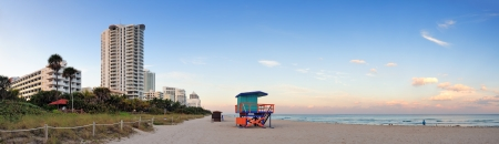 Miami Beach sunset panorama with lifeguard tower and hotels