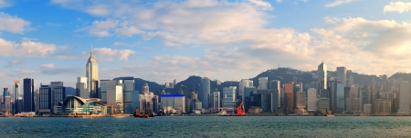 hong kong people: Hong Kong Victoria Harbor in afternoon with urban city skyline and colorful cloud Stock Photo