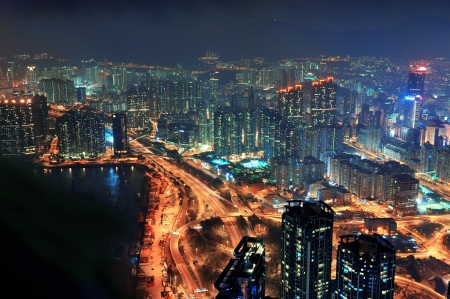 Victoria Harbor aerial view with Hong Kong skyline and urban skyscrapers at night  photo